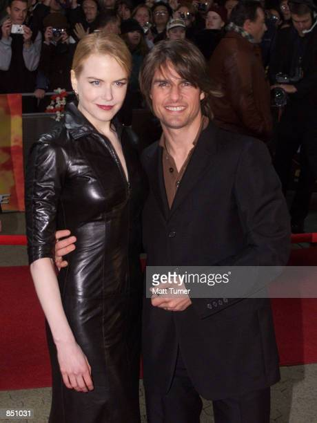Actor Tom Cruise and his wife Nicole Kidman pose for photographers at the Sydney premiere of 'Mission Impossible 2' May 30 2000 at Fox Studios in...