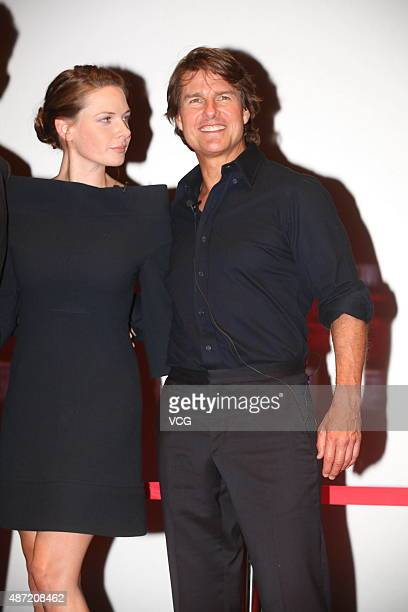 Actor Tom Cruise and Swedish actress Rebecca Ferguson attend the premiere of Christopher McQuarrie's film Mission Impossible Rogue Nation on...