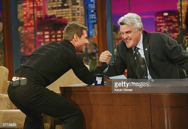 Actor Tom Cruise arm wrestles with Jay Leno at the Tonight Show with Jay Leno at NBC Studios on December 1 2003 in Burbank California