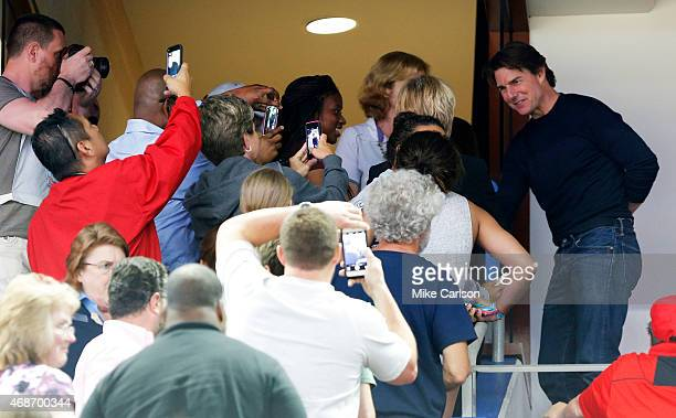 Actor Tom Cruise greets fans after the NCAA Women's Final Four Semifinal between the Maryland Terrapins and the Connecticut Huskies at Amalie Arena...