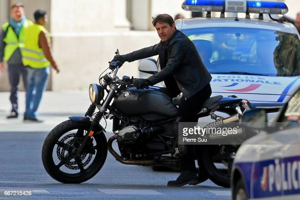 Actor Tom Cruise is pictured filming on a Motorbike on set for 'MissionImpossible 6 Gemini' filming on April 11 2017 in Paris France