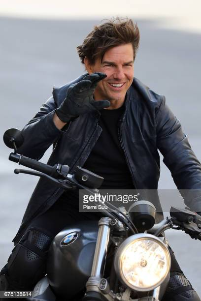 Actor Tom Cruise is seen riding a BMW bike on the set of 'Mission Impossible 6 Gemini' on Avenue de l'Opera on April 30 2017 in Paris France