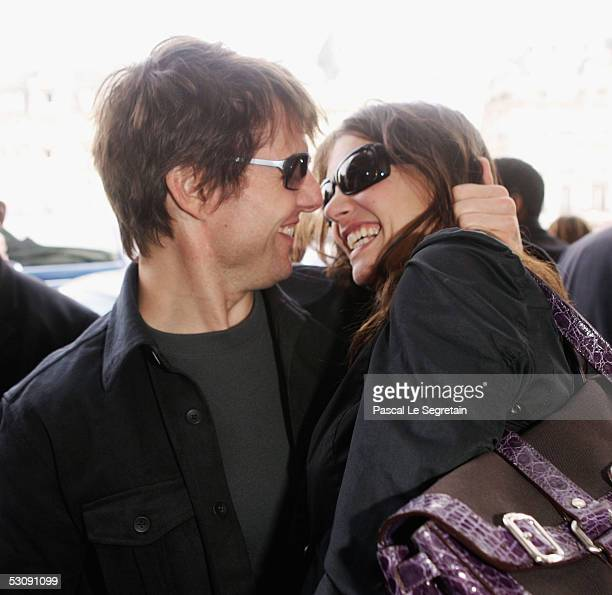 Actor Tom Cruise kisses his fiancee Katie Holmes at the Gare de Lyon railway station before they leave to Marseille ahead of the French premiere of...