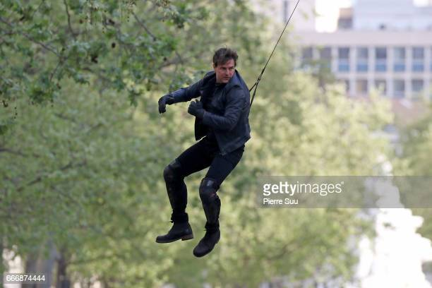 Actor Tom Cruise performs a stunt on set for 'MissionImpossible 6 Gemini' filming on April 10 2017 in Paris France