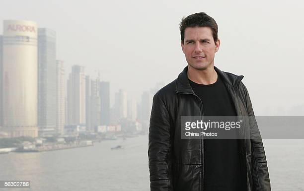 Actor Tom Cruise poses for the press at the end of a news conference promoting his new film Mission Impossible III atop Shanghai's historic Bund 18...