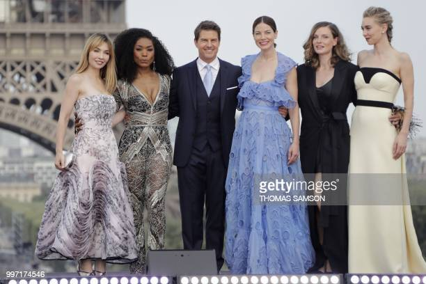 US actor Tom Cruise poses with French actress Alix Benezech US actresses Angela Bassett and Michelle Monaghan Swedish actress Rebecca Ferguson and...