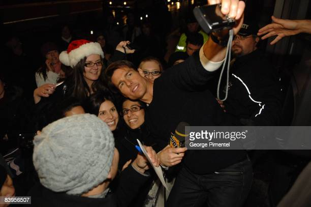 """Actor Tom Cruise posing with fans on MuchOnDemand for a live interview about his upcoming movie """"Valkyrie"""" at the MuchMusic HQ on December 8, 2008 in..."""