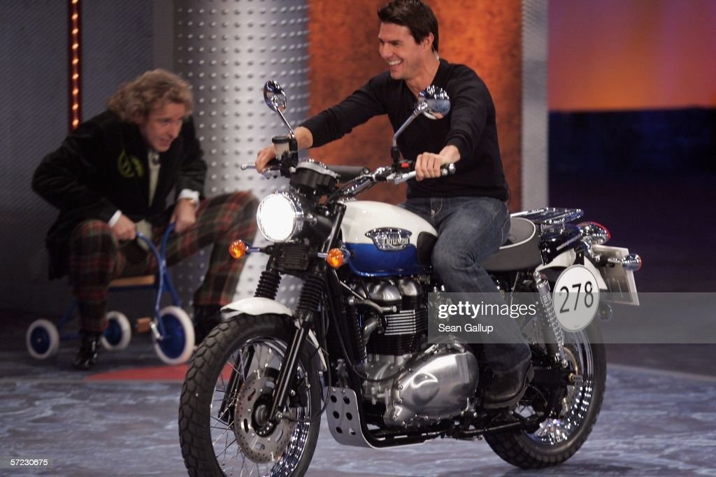 Actor Tom Cruise rides a motorcycle after losing a bet at the talk and game show 'Wetten Dass . . . ?' April 1, 2006 in Halle, Germany.