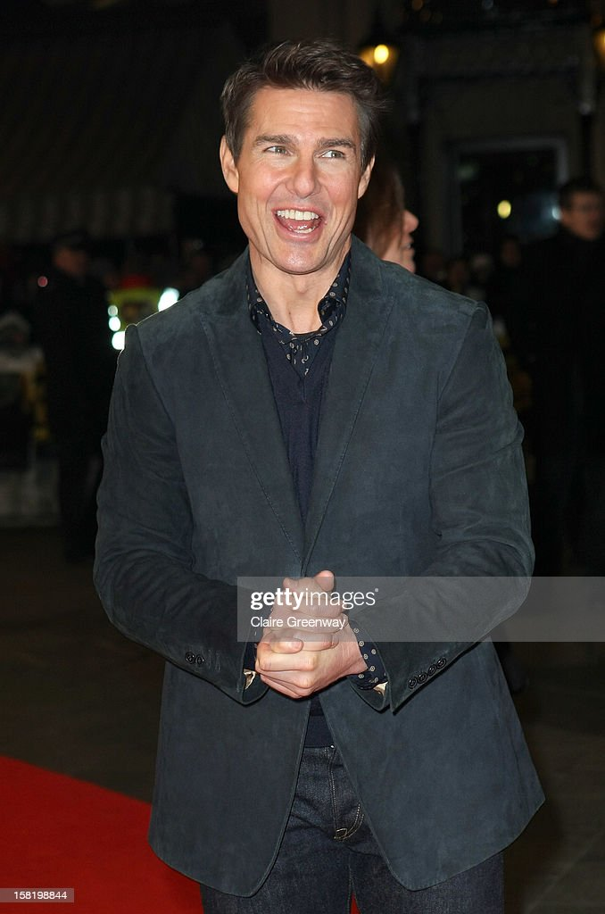 Actor Tom Cruise rubs his hands with cold as he attend the world premiere of 'Jack Reacher' at The Odeon Leicester Square on December 10, 2012 in London, England.