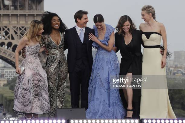 TOPSHOT US actor Tom Cruise share a laugh with French actress Alix Benezech US actresses Angela Bassett and Michelle Monaghan Swedish actress Rebecca...