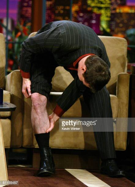 Actor Tom Cruise showing his lack of a tan appears on 'The Tonight Show with Jay Leno' at the NBC Studios on August 9 2004 in Burbank California