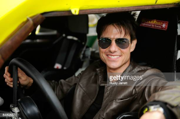 Actor Tom Cruise sits inside the car used in the film Days of Thunder on track prior to the start of the NASCAR Sprint Cup Series Daytona 500 at...