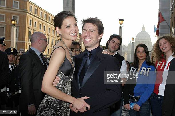 US actor Tom Cruise smiles flanked by his girlfriend Katie Holmes as they arrive for the David di Donatello Italian film awards in central Rome 29...