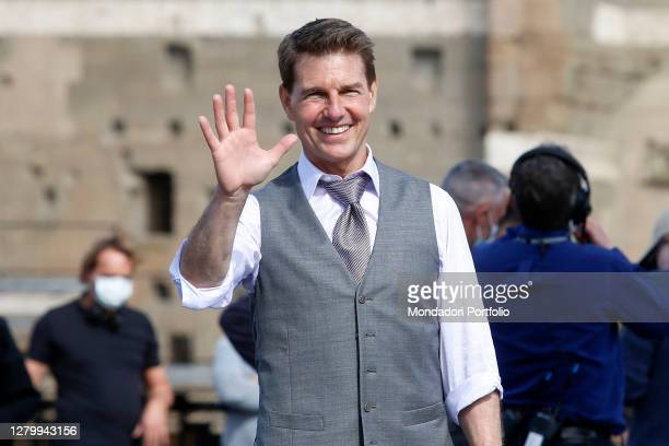 Actor Tom Cruise smiling and waving to his fans on the set of the film Mission Impossible 7 at Imperial Fora in Rome. Rome , October 12th 2020