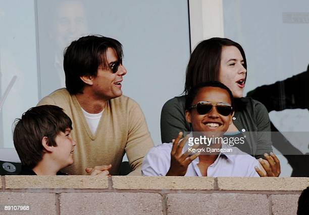 Actor Tom Cruise son Connor and daughter Isabella react to a missed goal by the Los Angeles Galaxy during the MLS game against AC Milan at The Home...