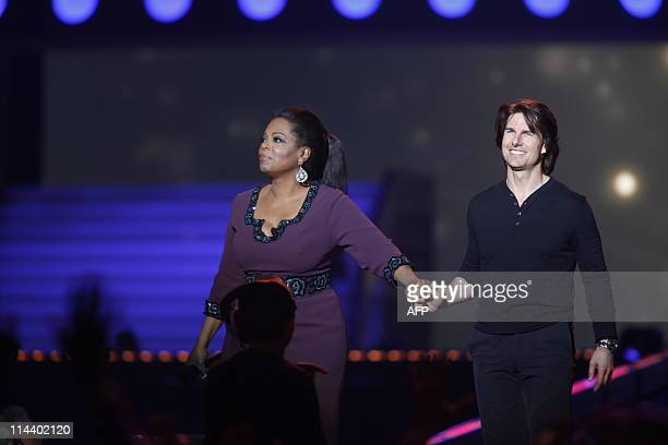 US actor Tom Cruise stands on stage with US television talk show personality Oprah Winfrey during the taping of the third to last Oprah Winfrey Show...
