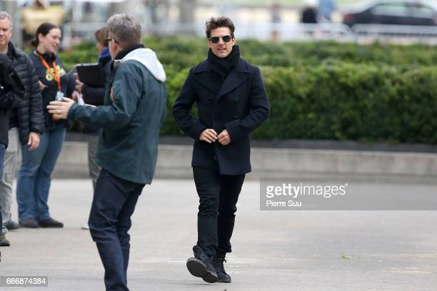 Actor Tom Cruise talks with Director Christopher McQuarrie on set for 'MissionImpossible 6 Gemini' filming on April 10 2017 in Paris France
