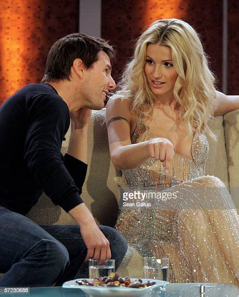 """Actor Tom Cruise talks with model Michelle Hunziker at the talk and game show """"Wetten Dass . . . ?"""" April 1, 2006 in Halle, Germany."""