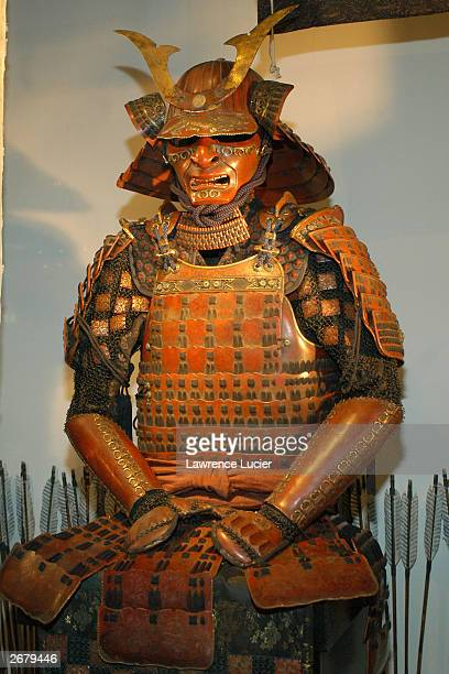 Actor Tom Cruise's costume from the film The Last Samurai is shown October 29 2003 in the store front window of Barneys New York in New York City