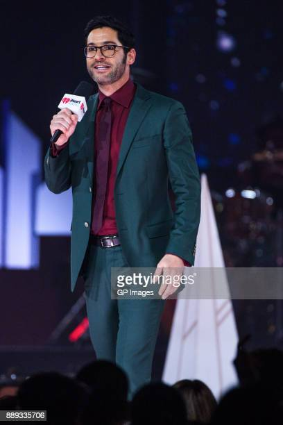 Actor Tom Ellis speaks on stage during the 2017 iHeartRadio Canada Jingle Ball at the Air Canada Centre on December 9 2017 in Toronto Canada