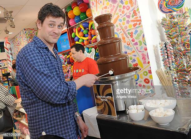 Actor Tom Everett Scott attends Dylan's Candy Bar and Milk Bookies Partner for The LA Launch of the 50th anniversary Charlie and the Chocolate...