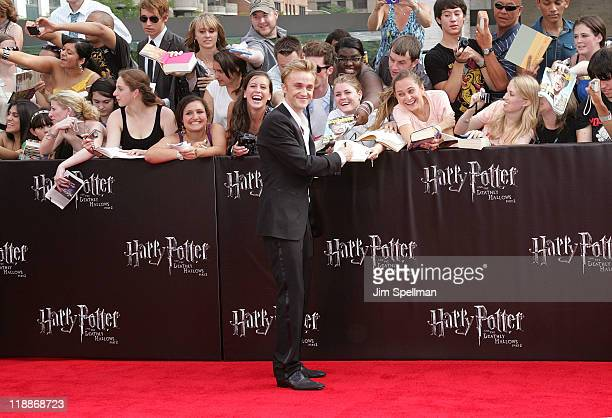 Actor Tom Felton and fans attend the premiere of 'Harry Potter and the Deathly Hallows Part 2' at Avery Fisher Hall Lincoln Center on July 11 2011 in...