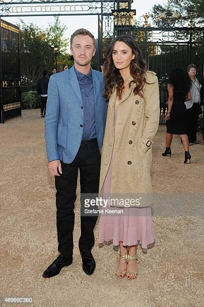 Actor Tom Felton and Jade Olivia attend the Burberry 'London in Los Angeles' event at Griffith Observatory on April 16 2015 in Los Angeles California
