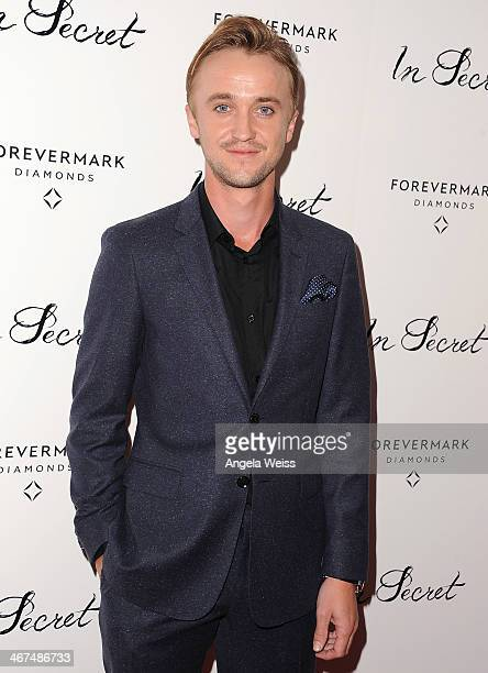 Actor Tom Felton arrives at the Los Angeles premiere of 'In Secret' at ArcLight Hollywood on February 6 2014 in Hollywood California