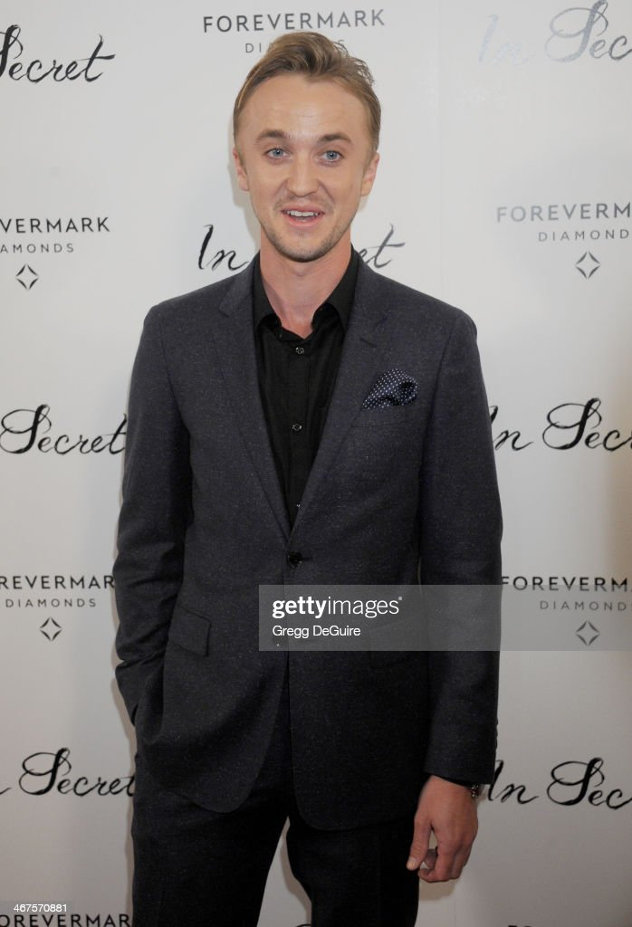 Actor Tom Felton arrives at the Los Angeles premiere of 'In Secret' at ArcLight Hollywood on February 6, 2014 in Hollywood, California.