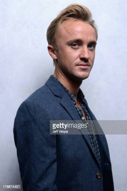 Actor Tom Felton of 'Therese' poses at the Guess Portrait Studio during 2013 Toronto International Film Festival on September 7 2013 in Toronto Canada