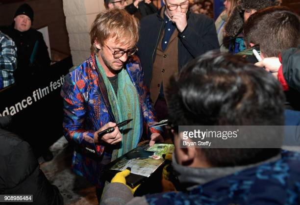 Actor Tom Felton signs autographs for fans during the 2018 Sundance Film Festival on January 22 2018 in Park City Utah