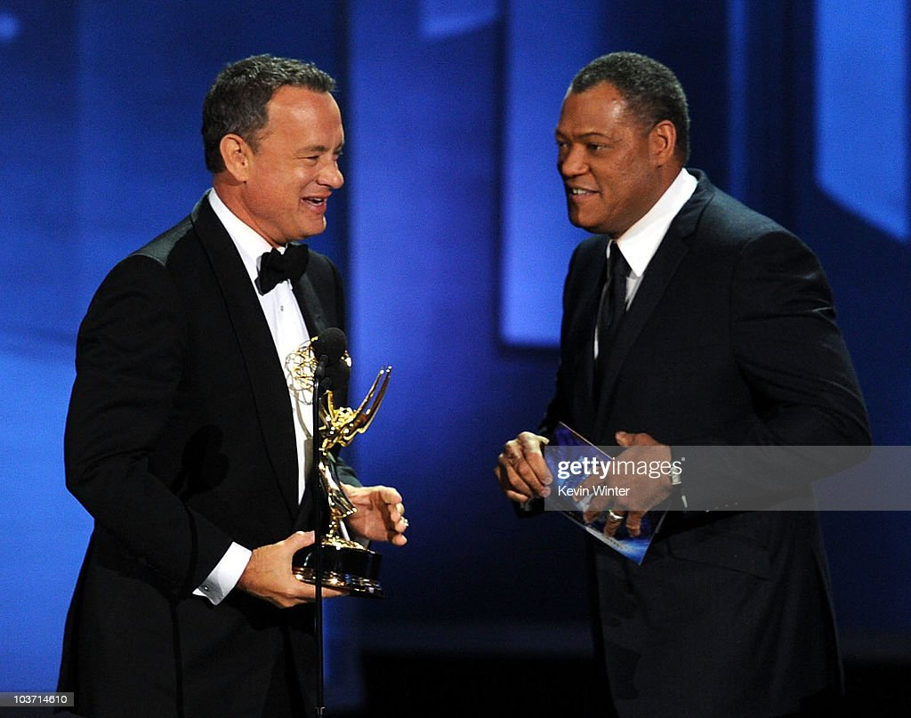 Actor Tom Hanks accepts the Outstanding Miniseries award for 'The Pacific' from actor Laurence Fishburne onstage at the 62nd Annual Primetime Emmy Awards held at the Nokia Theatre L.A. Live on August 29, 2010 in Los Angeles, California.