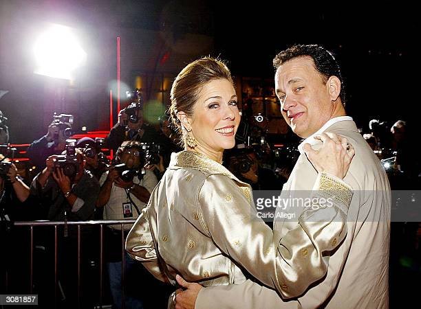 Actor Tom Hanks and actress Rita Wilson arrive for the world premiere of the movie 'Ladykillers' at the El Capitan Theatre March 12 2004 in Hollywood...