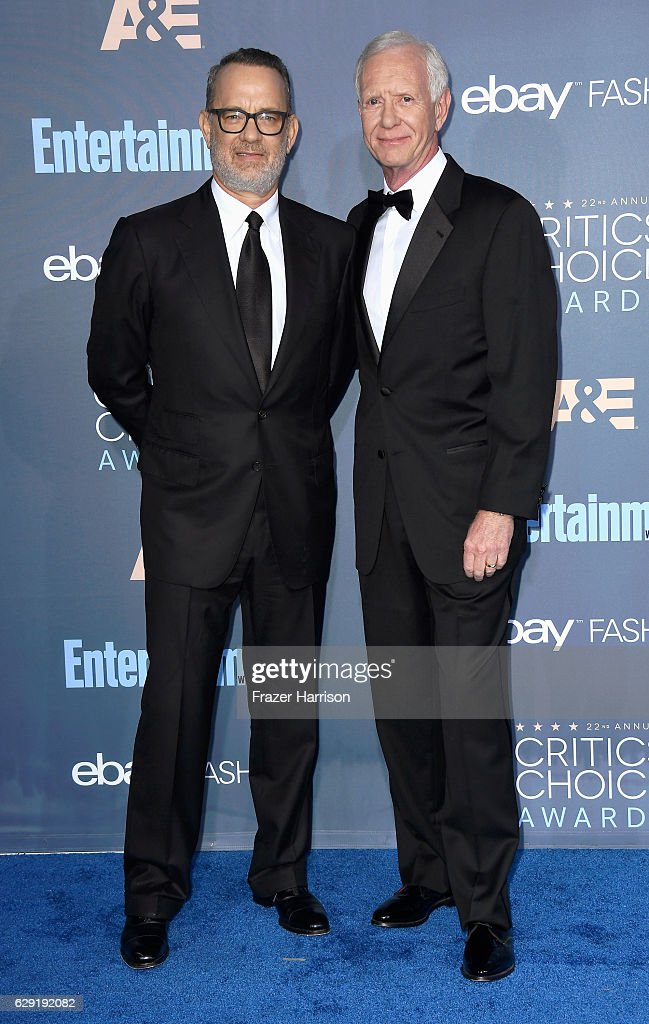 Actor Tom Hanks (L) and Chesley 'Sully' Sullenberger attend The 22nd Annual Critics' Choice Awards at Barker Hangar on December 11, 2016 in Santa Monica, California.