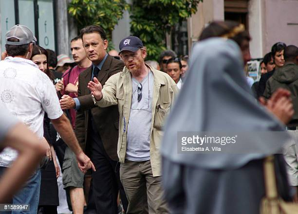 """Actor Tom Hanks and director Ron Howard work on the set of the movie """"Angels And Demons"""" at the Pantheon on June 9, 2008 in Rome, Italy."""