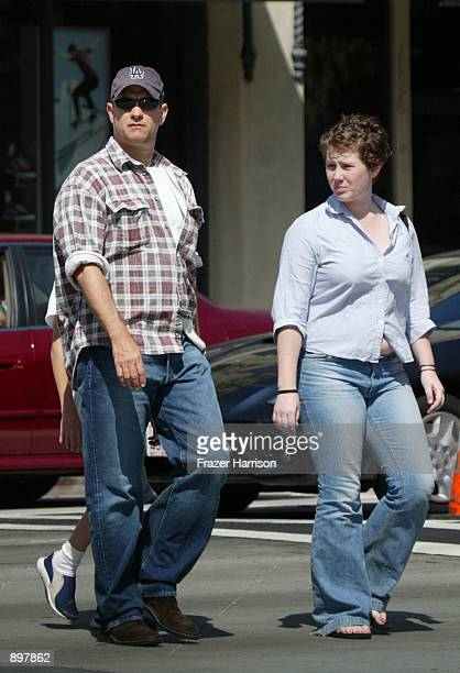 Actor Tom Hanks and his daughter Elizabeth walk down Broadway June 22 2002 in Santa Monica California