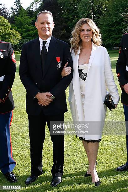 Actor Tom Hanks and his wife actress Rita Wilson attend the Flag Ceremony after Tom Hanks Tom Brokaw Gordon 'Nick' Mueller received the Legion...