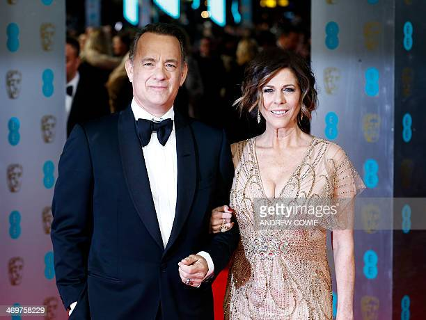 Actor Tom Hanks and his wife Rita Wilson arrive on the red carpet for the BAFTA British Academy Film Awards at the Royal Opera House in London on...