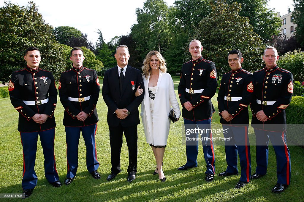 Actor Tom Hanks and his wife Rita Wilson attend the Flag Ceremony after Tom Hanks, Tom Brokaw & Gordon 'Nick' Mueller received the Legion d'Honneur Medal. Held at USA Ambassy in Paris on May 19, 2016 in Paris, France.