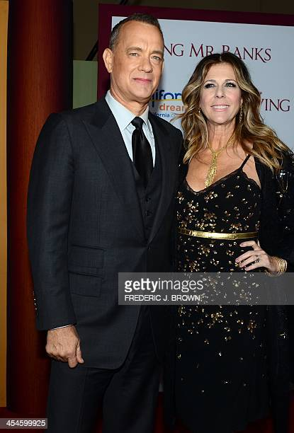 Actor Tom Hanks and his wife Rita Wilson pose on arrival for the US Premiere of the film 'Saving Mr Banks' at the Walt Disney Studios in Burbank...