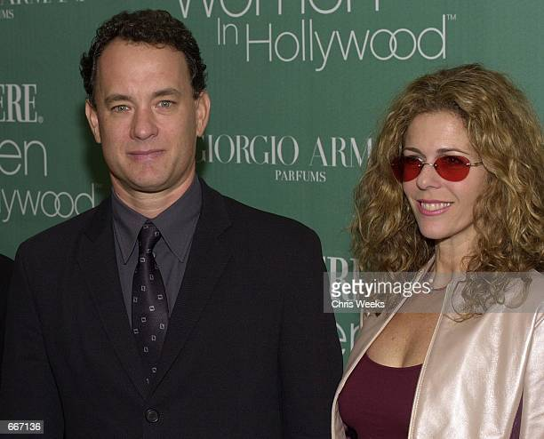 Actor Tom Hanks and his wife Rita Wilson poses for photographers October 11 2000 as they arrive at the 7th Annual Premiere Women in Hollywood...