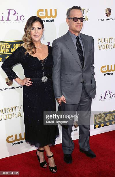 Actor Tom Hanks and wife actress Rita Wilson attend the 19th Annual Critics' Choice Movie Awards at Barker Hangar on January 16 2014 in Santa Monica...