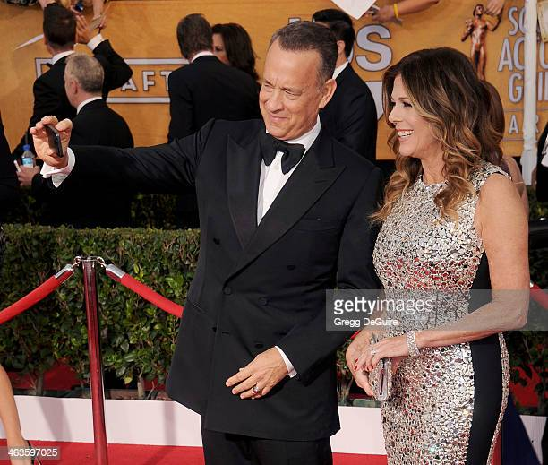 Actor Tom Hanks and wife Rita Wilson arrive at the 20th Annual Screen Actors Guild Awards at The Shrine Auditorium on January 18 2014 in Los Angeles...