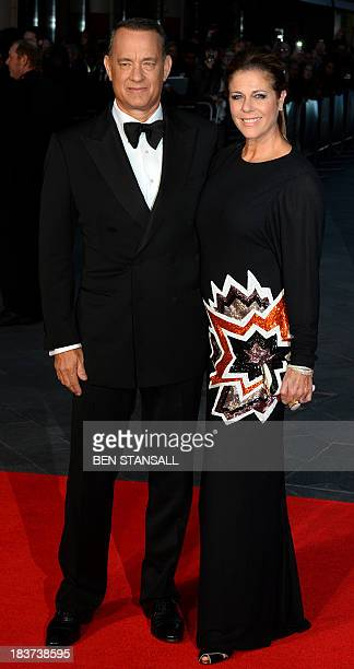 Actor Tom Hanks and wife Rita Wilson attend the UK premier of 'Captain Phillips' in Leicester Square in London on October 9, 2013. AFP PHOTO / BEN...