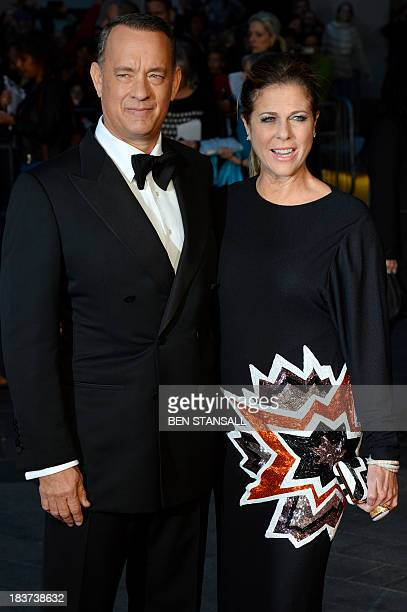 Actor Tom Hanks and wife Rita Wilson attend the UK premier of 'Captain Phillips' in Leicester Square in London, on October 9, 2013. AFP PHOTO / BEN...
