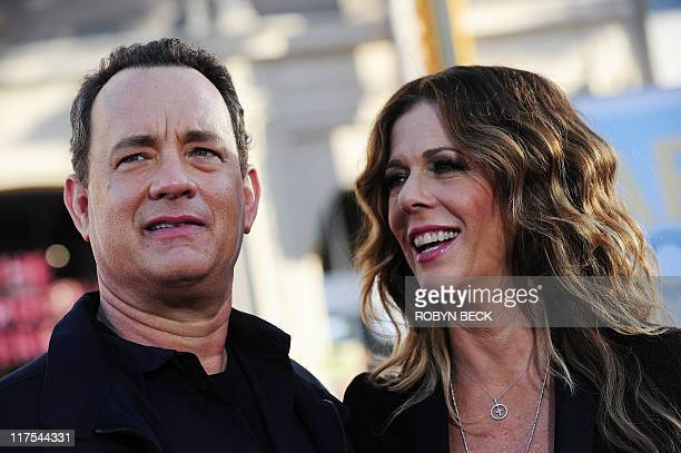 Actor Tom Hanks arrives with his wife actress and producer Rita Wilson for the world premiere of Larry Crowne June 27 2011 at the Chinese Theatre in...