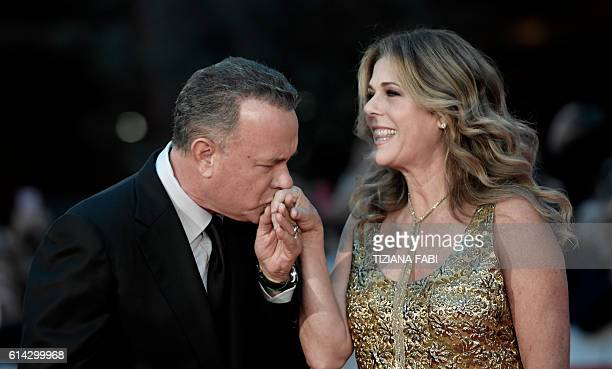 US Actor Tom Hanks arrives with his wife Rita Wilson at the Rome Film Festival to receive a lifetime achievement award on October 13 2016 / AFP /...