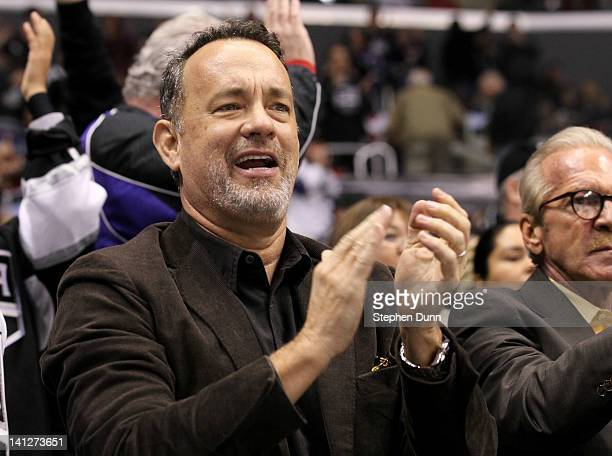 Actor Tom Hanks cheers after the Los Angeles Kingsfirst goal against the Detroit Red Wings at Staples Center on March 13 2012 in Los Angeles...