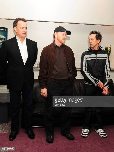 Actor Tom Hanks director Ron Howard and producer Brian Grazer meet the press during the ceremonial first pitch prior to the professional baseball...