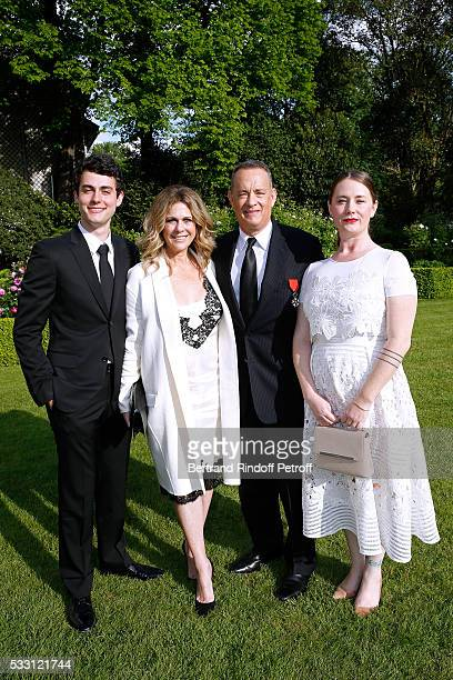 Actor Tom Hanks his wife actress Rita Wilson their son Truman Theodore Hanks and Tom's daughter Elizabeth Ann Hanks attend the Flag Ceremony after...